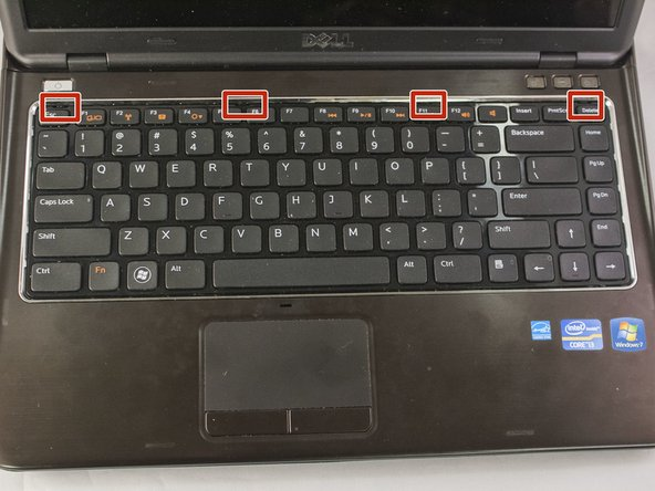 Image 1/3: Carefully flip laptop right side up and open to view the keyboard.