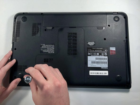 Using the Phillips #1 screwdriver, remove the 6mm screw on the panel, exposing the hard drive.