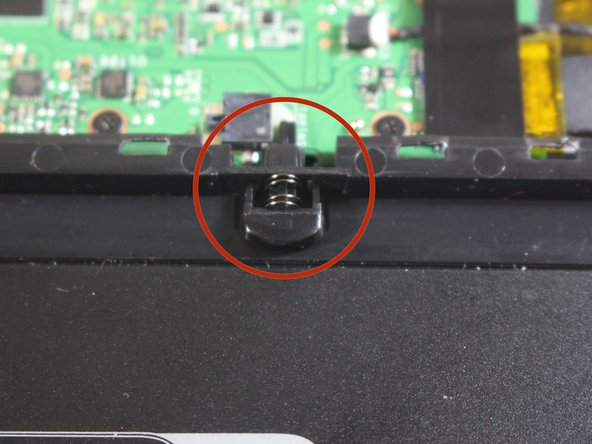 With tweezers gently squeeze and remove docking indicator device