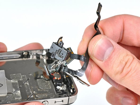 Remove the headphone jack cable from the iPhone.