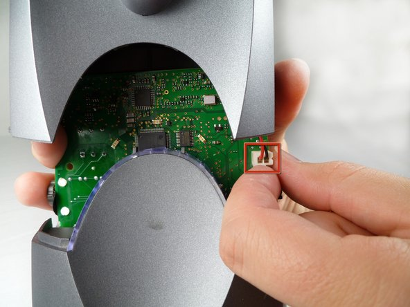 Image 1/3: Carefully disconnect the wires from the motherboard.