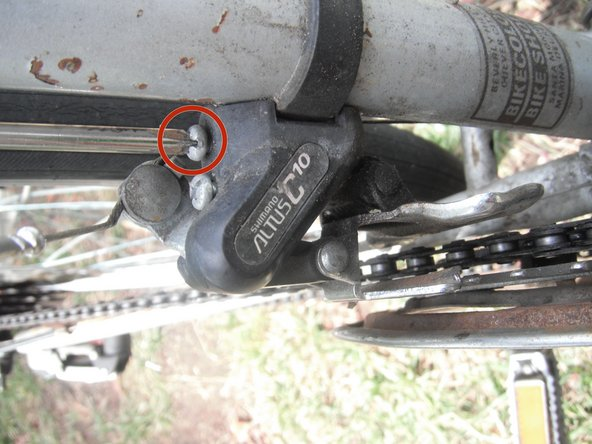Shift the front derailleur as far outwards as you can.