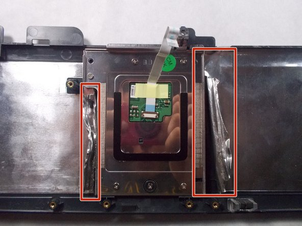 Turn the frame over so that the underside of the touchpad is exposed.