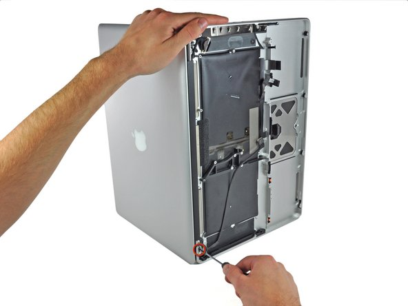Open your MacBook Pro so the display is perpendicular to the upper case.