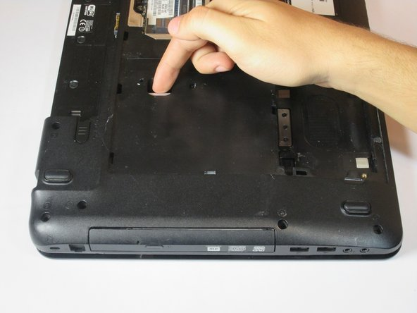 Image 1/2: The Disk Drive will begin sliding out of its slot. Remove Disk Drive from the laptop by hand.