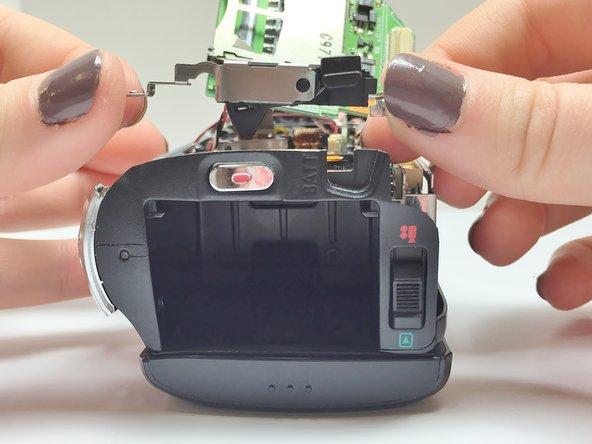 Image 2/2: Ensure that the Battery Eject button is lined up properly.