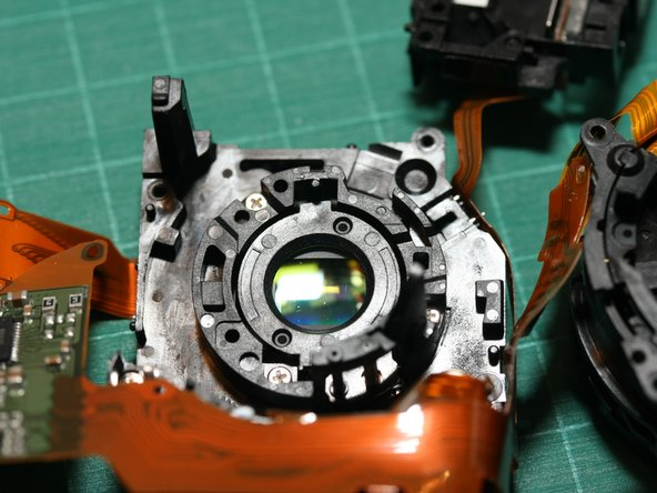 In the rear half of the lens module, you can see some of the dust on the other side of the rear lens element in this photo. The sensor itself was clean.