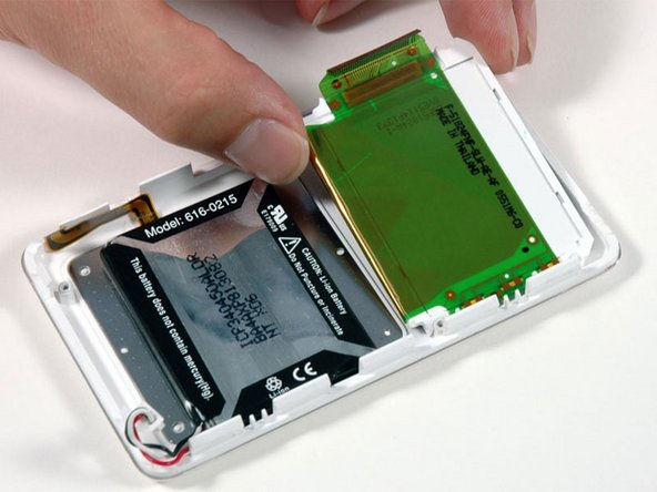 Lift the display panel out of the iPod. There may be some mild adhesive connecting the display to the front panel.
