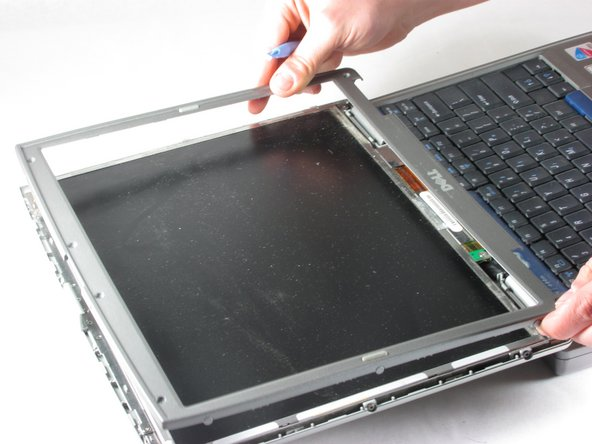 Lift the plastic around the screen off after it is un-clipped by pulling straight up on it.