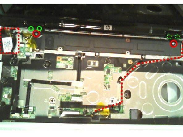 Remove silver screws shown as red circles in picture. They hold the plastic pieces that hide the display hinges.