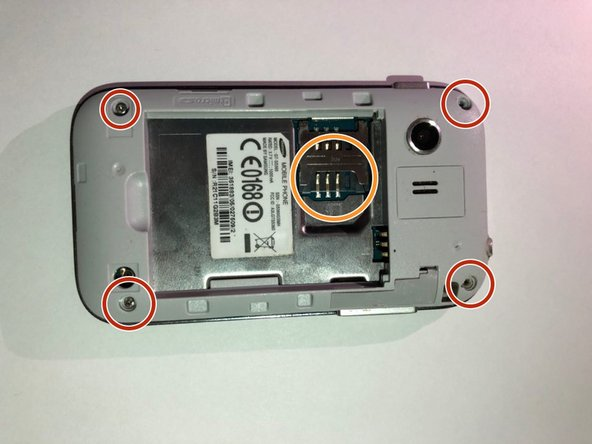 Use the screwdriver with a PH000 screwdriver head to remove the four 5mm screws located in the corner of the interior back panel.