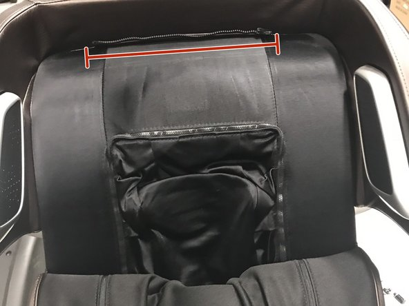 Next we need to unzip the front of the chair . do so by unzipping all zippers shown in this order. 1 on at top of chair and one at bottom, then one underneath the leather back-pad.