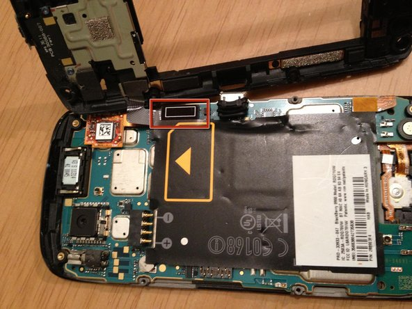 Image 1/2: Gently pry ribbon cable off, and then you will have the back cover fully removed