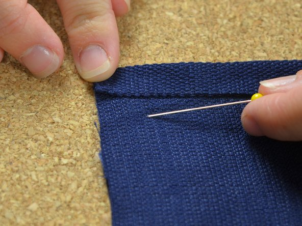 Starting at one end of the seam, match the corners and pin them together.
