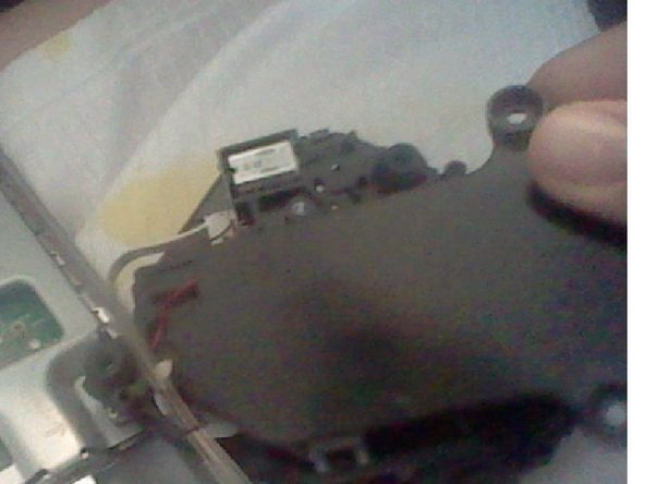 Remove the 2 screws and take the black bottom piece of the old Optical drive.