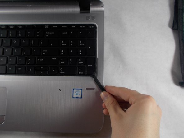 To remove the keyboard, gently insert the spudger underneath it along an edge and work it around to unsnap