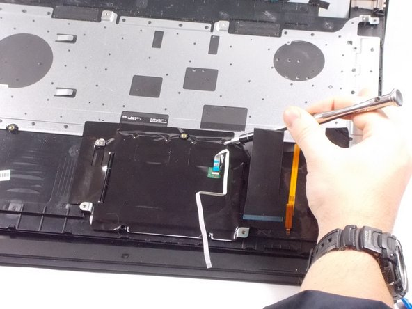 Open the inner laptop and remove the two screws located in the picture.