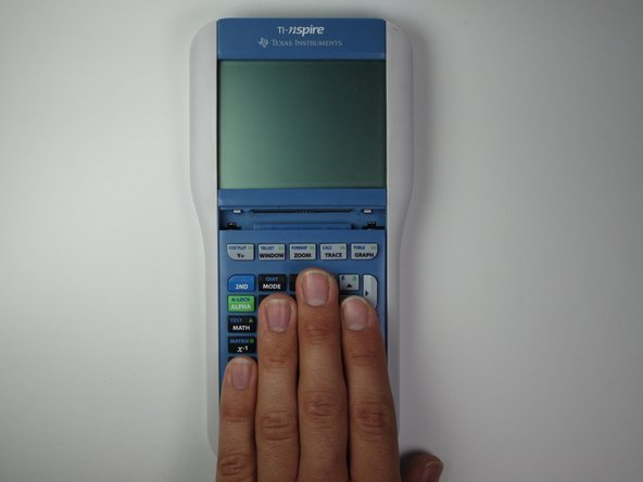 Put your hand on the keypad, slide the keypad down about a half inch, and pull up to remove the keypad.