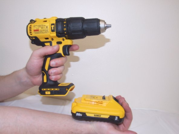 Remove the battery from drill by sliding the battery outwards away from the drill.