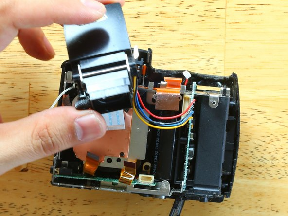 Swing the EVF module free from the chassis.