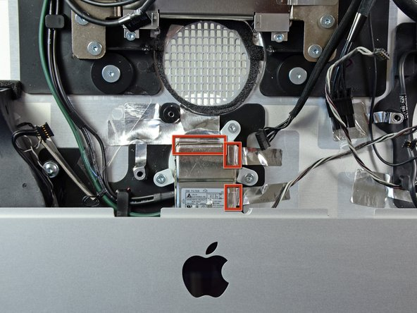 Image 1/1: It is not necessary to completely remove the tape from the body of the iMac.