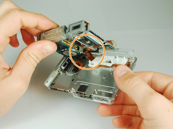 Carefully disengage the internal components from the casing by lifting at the bottom end and giving a gentle tug.