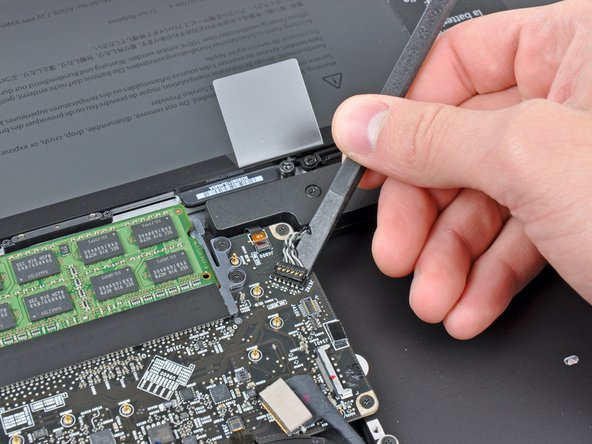 Use the flat end of a spudger to lift the subwoofer & right speaker connector out of its socket on the logic board.