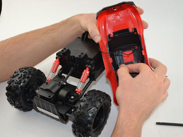 Image 1/1: Remove the R/C truck top completely.