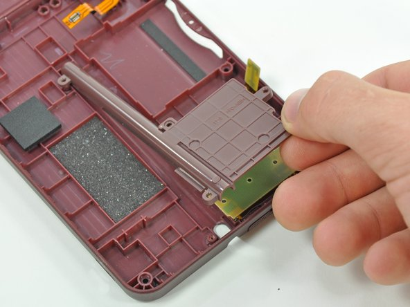 Remove the stylus housing from the handheld console.