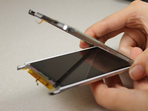 Image 3/3: Use a Slot SL1.5 screwdriver to pry the touchscreen shell from the display component using the 4 slots around the entire component