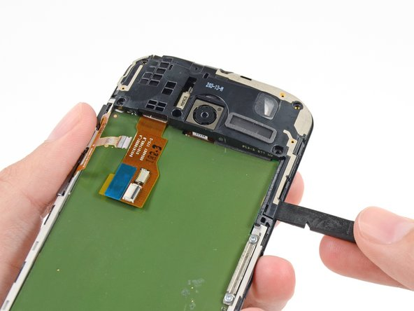 Image 1/3: Remove the headphone jack/speaker assembly.