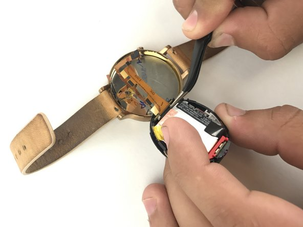 Use tweezers to remove a rubber strip on the back of the connector.