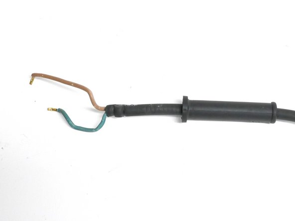 With a size 3 slotted screwdriver, unscrew the two 10mm brass screws to release the power cord.