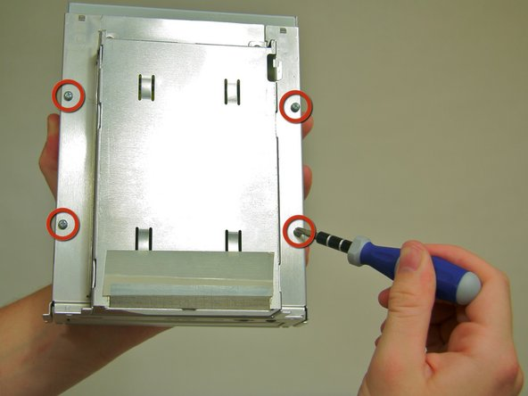 Lift the two metal tabs on the back of the shielding and remove.