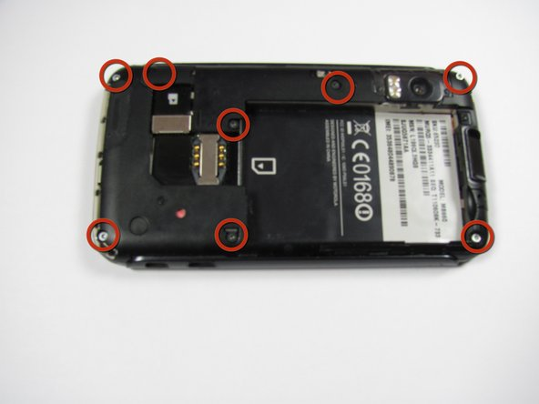 Image 1/1: After the battery is removed, locate the eight screws on the back of the phone.