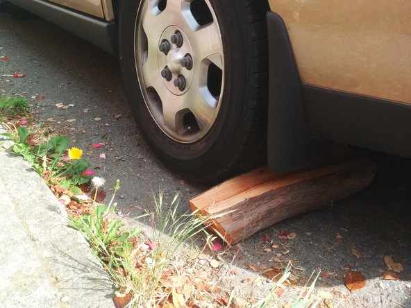 Take care to prevent the car from rolling backwards.  If it rolls off the jack or stands, it may cause serious damage to the car or you.