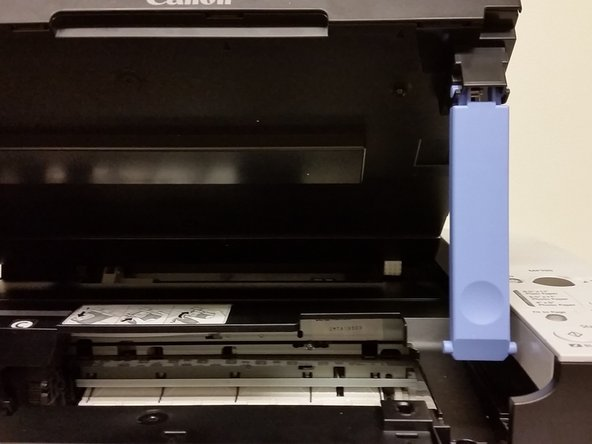 Image 2/3: Lower the scanning unit until the scanning unit support seats in the scanning unit support slot.