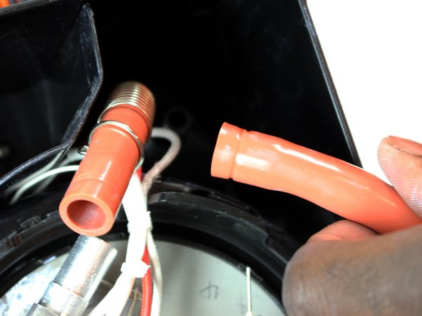Once the clamp is free on the opposing end, gently pull the hose upwards to remove it.