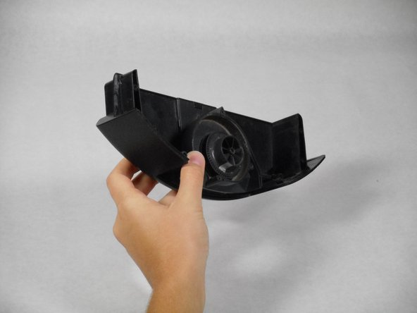 Image 1/3: Remove the casing from the fan and battery component by pulling it straight up.