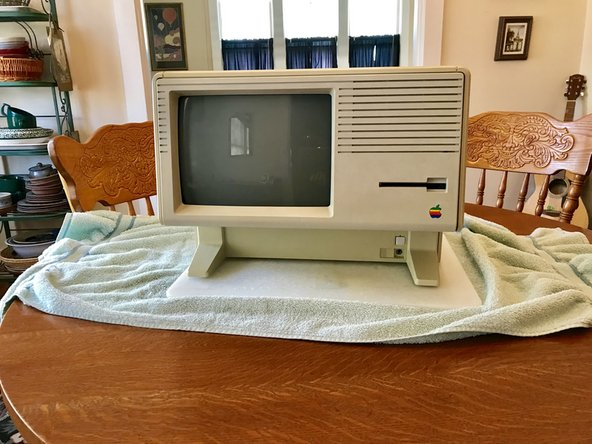Follow the Apple Lisa disassembly guide steps 1-9.