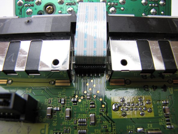 Now disconnect the controller port panel connector by lifting and jiggling it carefully. It should come off easily.