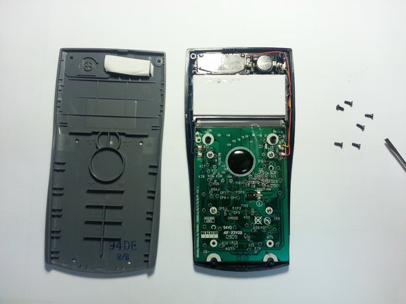 Carefully remove the back plate to reveal the circuit board and the battery.