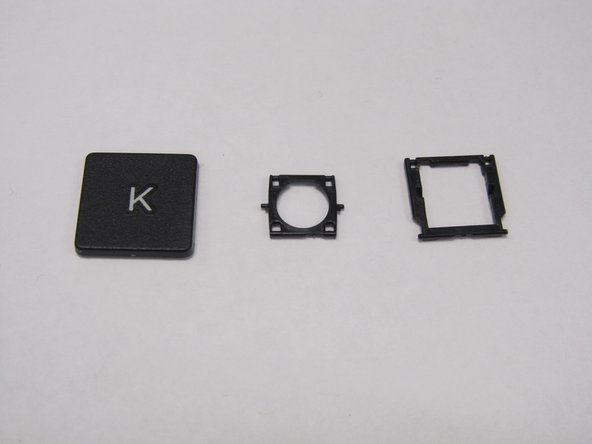 There are two square, black pieces under the key. A smaller piece may be stuck to the back of the key piece.
