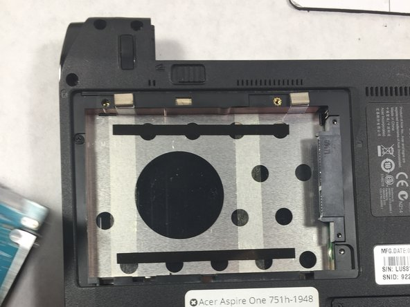 Remove the hard drive by sliding it to the left and pull it out.