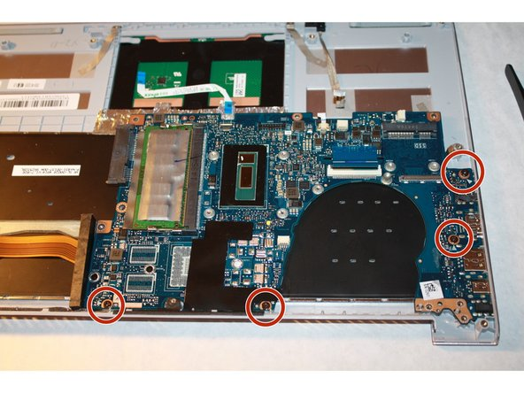 Detach the motherboard by removing the four screws using a PH-1 screwdriver.