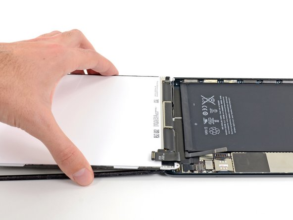 Image 1/2: Lift and remove the LCD from the iPad Mini.