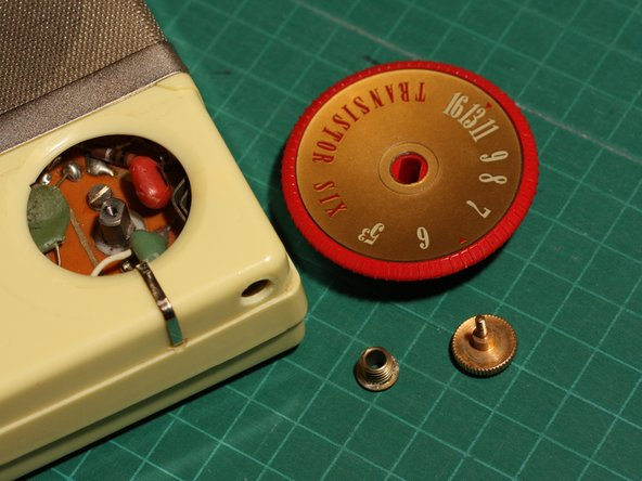 ...and then you can remove the screw and lift off the tuning dial.