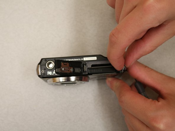 Once the case is open, there will be another switch on the right side of the battery. Push the switch to the right to release the battery. Now you can pull the battery out.