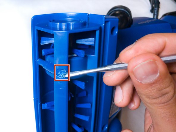 Remove the screw cap using the metal spudger.
