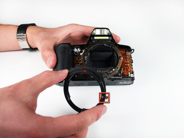 Use your fingers to remove the lens mounting ring.